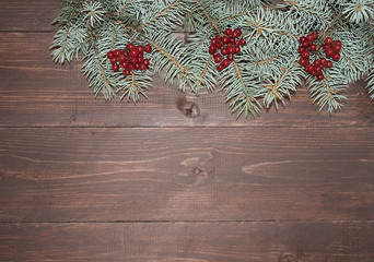 Christmas composition. Fir branches on a wooden background. Flat  top view.
