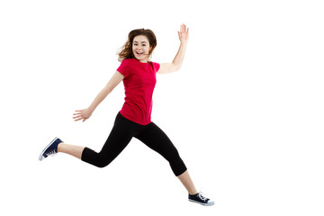 Young woman jumping on white background