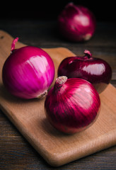 close up red onion on a wooden table