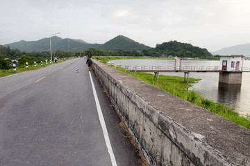 The road next to the reservoir