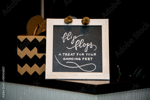 34bf562959b7b Blackboard advertising for flip flops at a wedding