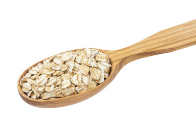 Oatmeal. Oat flakes in wooden spoon isolated on white background