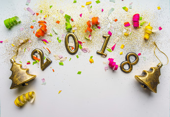 2018 new year background with confetti, sparkles, serpentine on white. Top view, close-up. Festive greeting card with copy spase.