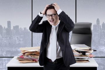 Asian manager having a headache