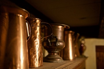 Antique Brass Jugs In Line