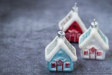 Christmas decoration on the Christmas tree in the form of houses