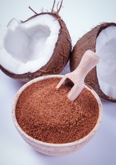 Coconut with coconut sugar isolated on white background.