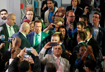 Former California governor and 'Mr. Universe' Arnold Schwarzenegger is surrounded by delegates and observers as he arrives for the COP23 UN Climate Change Conference 2017, hosted by Fiji but held in Bonn