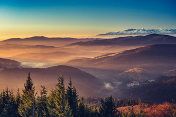 Fototapeten Gebirge panorama over misty Gorce to snowy Tatra mountains in the morning, Poland landscape