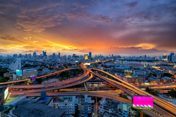 Wall Mural - Bangkok business district  Expressway and Highway top view, Thailand at sunset
