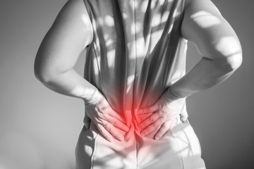 Women are back pain. Used hand support at waist. Symptoms of Office Syndrome.