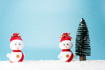 Christmas tree and snowman on snow