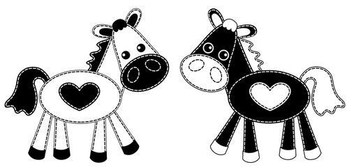 White and black patchwork horses.
