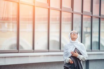 girl in hijab looking in the sky