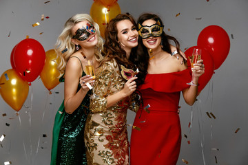 New Year Celebration. Beautiful Girls In Dresses At Party