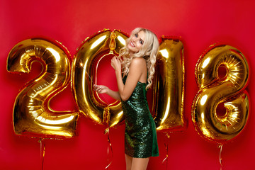 Happy New Year. Beautiful Woman With Balloons
