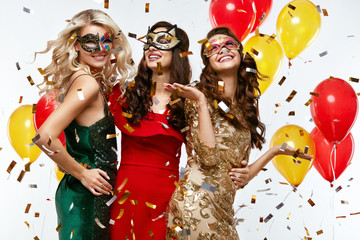 Holiday. Beautiful Women In Masks Celebrating New Year
