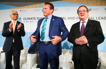 Mayor of Bonn Ashok-Alexander Sridharan, Former California governor and 'Mr. Universe' Arnold Schwarzenegger and Armin Laschet of the CDU Party gesture during the COP23 UN Climate Change Conference 2017, hosted by Fiji but held in Bonn