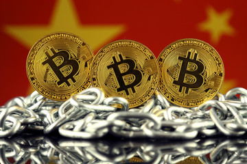 Physical version of Bitcoin (new virtual money), chain and China Flag. Conceptual image for investors in cryptocurrency and Blockchain Technology in China.