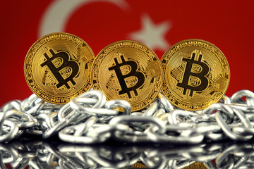 Physical version of Bitcoin (new virtual money), chain and Turkey Flag. Conceptual image for investors in cryptocurrency and Blockchain Technology in Turkey.