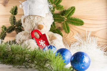 Teddy Bear Christmas Concept Blue Balls Wooden Background