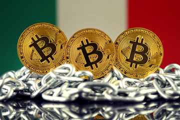 Physical version of Bitcoin (new virtual money), chain and Italy Flag. Conceptual image for investors in cryptocurrency and Blockchain Technology in Italy.