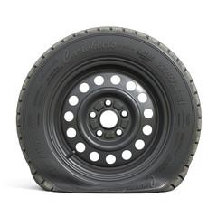 Punctured black car wheel isolated on white background