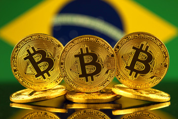 Physical version of Bitcoin (new virtual money) and Brazil Flag. Conceptual image for investors in cryptocurrency and Blockchain Technology in Brazil.