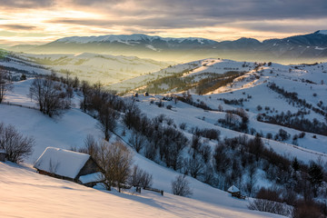 village in mountains on winter sunrise. beautiful landscape in Carpathians
