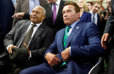 Former California governor and 'Mr. Universe' Arnold Schwarzenegger and COP 23 President Prime Minister Frank Bainimarama of Fiji gesture during the COP23 UN Climate Change Conference 2017, hosted by Fiji but held in Bonn