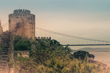 View of Rumelihisar is a fortress located in the Istanbul, Turkey on a hill at the European side of the Bosphorus. Old photo style.