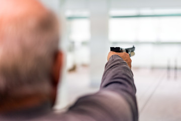 Aiming the target and Shooting with Pistol, Indoors