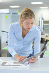 business woman using tablet for planning