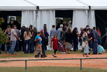 An overflow crowd leaves the First Baptist Church of Sutherland Springs worship service on a ballfield, the first service since a gunman opened fire inside the small church a week earlier in Sutherland Springs