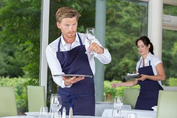 Waiter checking glassware
