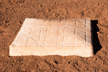 White baseball base in the dirt