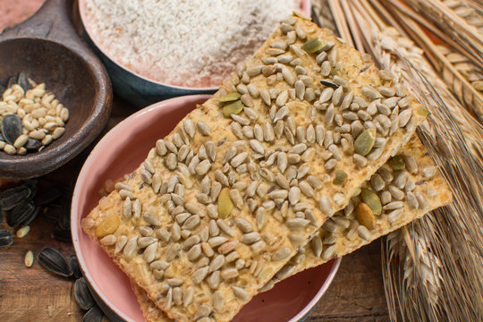 Whole grain wheat flour, sunflowers seeds and fresh baked crackers
