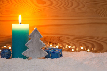 Christmas blue decoration and Advent candle. Christmas card.