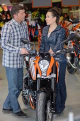 femlae motorbike seller advising client