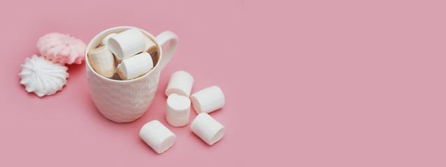 Cup of Hot Chocolate or Cocoa with Marshmallows and meringue on Pink background. Top View, flat lay