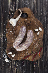 Raw sausages with garlic and spicy