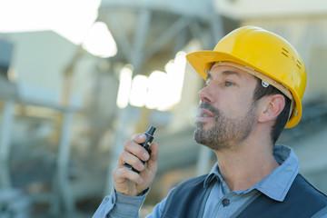 builder smoking cigarette on construction site