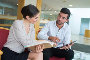 Salesman looking at brochures with customer