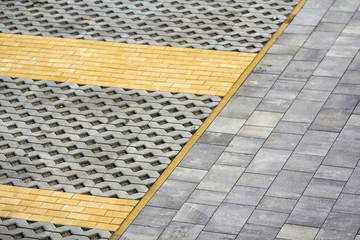 Perspective view of gray and yellow brick stones on street and sidewalk