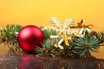 Christmas decoration with Beautiful colorful balls, christmas tree and fir cones on wooden background.