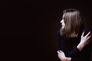 Woman in depression alone with  problems (difficulties, psychology, body language, gestures, loneliness concept)