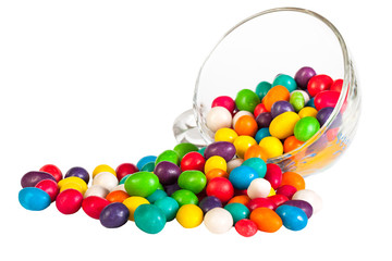 colorful  sprinkle candies in a glass isolated on a white background