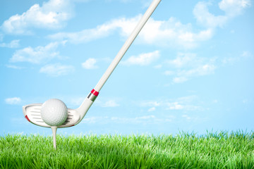Driver about to hit the Ball: Series of golfing equipment concept pictures..Shot in studio on grass with blue background