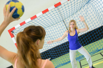woman about to score during handball match