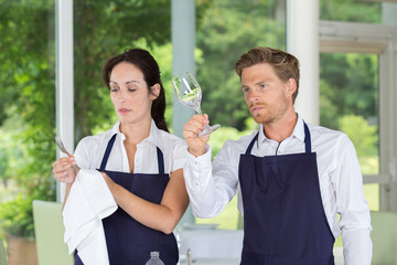 catering restaurant waitress and waiter setting table
